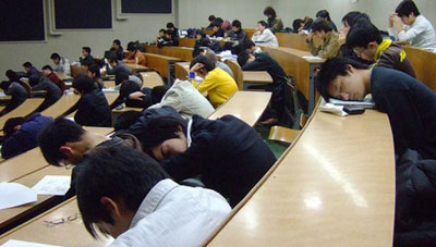 Picture of students sleeping in a lecture hall